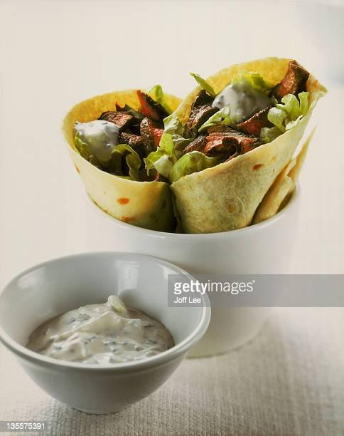 Tortilla wraps with lamb & salad, and yoghurt sauce