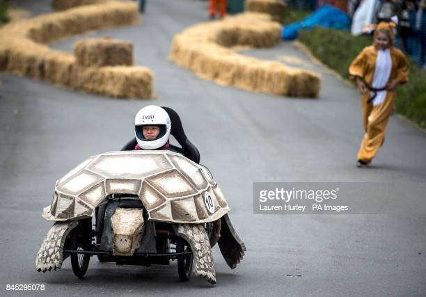 A tortoise and the hare themed kart take part during the Gravity Grand Prix a fundraising downhill kart race driven by gravity following a short push...