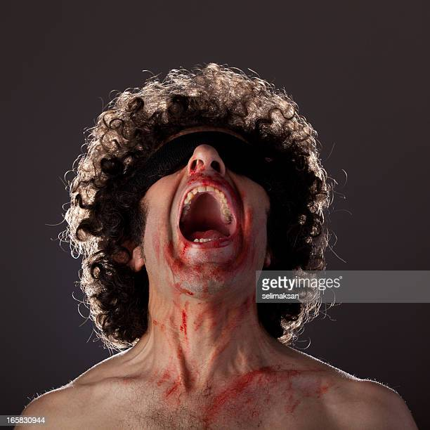 Tortured man screaming