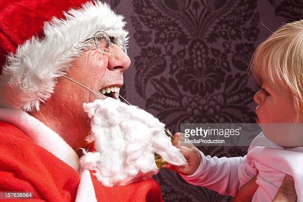torturing santa - naughty santa stock photos and pictures