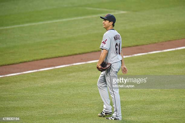Toru Murata of the Cleveland Indians walks to the dug out after getting taken out the forth inning in his major league debut in the first inning...
