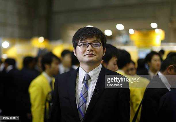 Toru Nishikawa president and chief executive officer of Preferred Networks Inc poses for a photograph after an interview at the International Robot...
