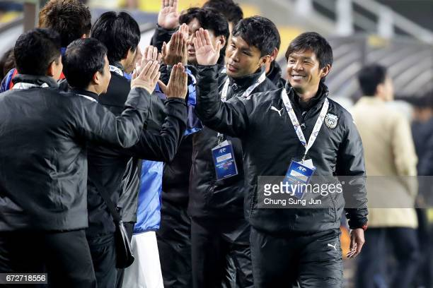 Toru Oniki head coach of Kawasaki Frontale celebrates after winning the AFC Champions League Group G match between Suwon Samsung Bluewings and...