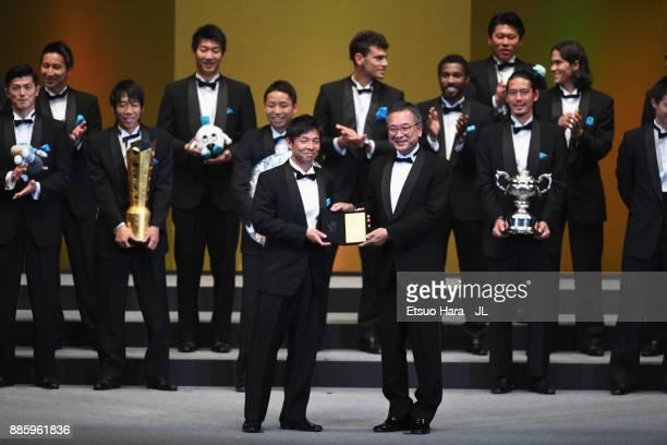 Toru Oniki of Kawasaki Frontale receives the Champion Head Coach Award by JLeague Chairman Mitsuru Murai during the 2017 JLeague Awards at Yokohama...