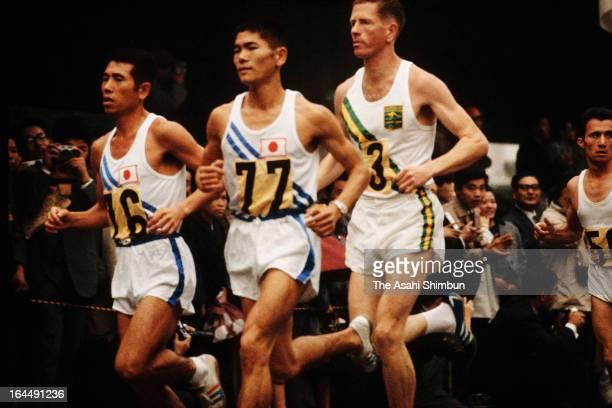 Toru Terasawa and Kokichi Tsuburaya of Japan compete in the Men's Marathon during Tokyo Olympic on October 21 1964 in Tokyo Japan