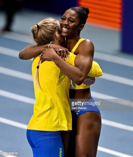 Torun , Poland - 6 March 2021; Khaddi Sagnia of Sweden, right, is congratulated by a team-mate after winning bronze in the Women's Long Jump Final...