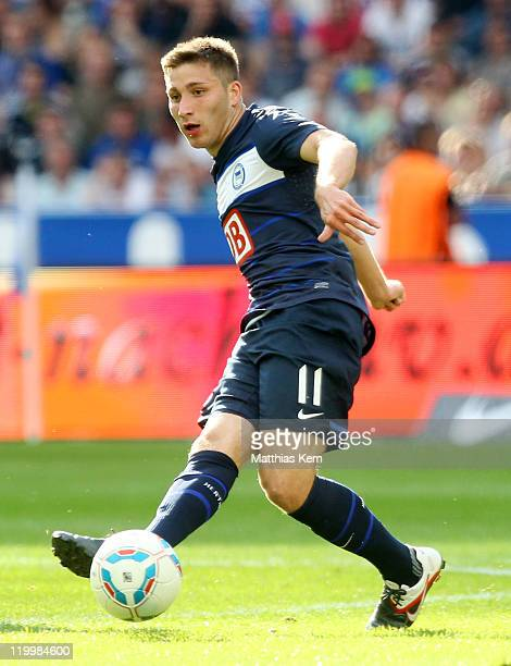 Torun Tunay of Berlin passes the ball during the preseason friendly match between Hertha BSC Berlin and Real Madrid at Olympic Stadium on July 27...