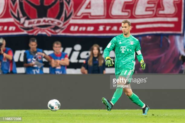 Torwart Manuel Neuer of Bayern Muenchen controls the ball during the Bundesliga match between RB Leipzig and Bayern Muenchen at Red Bull Arena on...