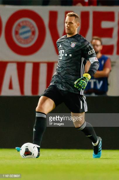 Torwart Manuel Neuer of FC Bayern Muenchen controls the ball during the DFB Cup first round match between Energie Cottbus and FC Bayern Muenchen at...