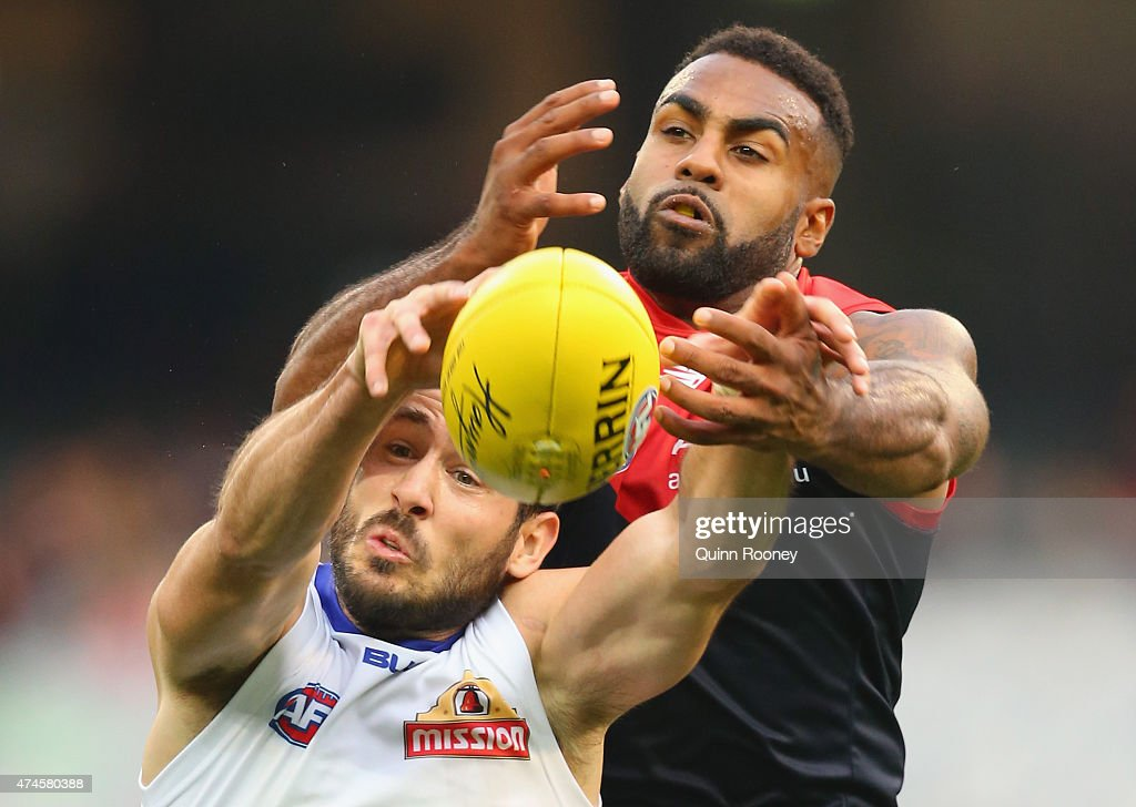 Tory Dickson of the Bulldogs and Heritier Lumumba of the Demons compete for a mark during the round eight AFL match between the Melbourne Demons and the Western Bulldogs at Melbourne Cricket Ground on May 24, 2015 in Melbourne, Australia.