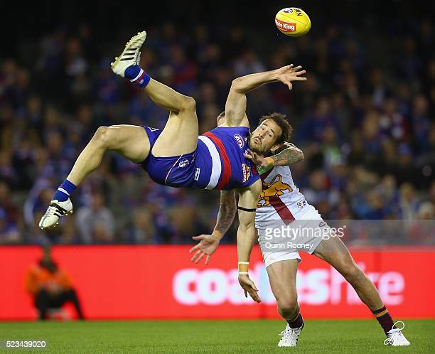 Tory Dickson of the Bulldogs attempts to mark over the top of Claye Beams of the Lions during the round five AFL match between the Western Bulldogs...
