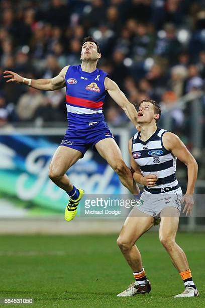 Tory Dickson of the Bulldogs competes for the ball over Jake Kolodjashnij of the Cats during the round 19 AFL match between the Geelong Cats and the...