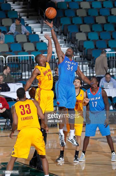 Tory Jackson of the Fort Wayne Mad Ants and Curtis Sumpter of the Tulsa 66ers jump for the ball during their game at the 2012 NBA DLeague Showcase on...
