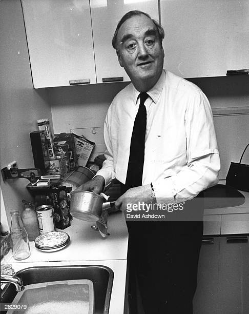 Tory Party chairman Sir William Whitelaw washing-up at his Chelsea home after declaring his intention to enter the party leadership contest. Original...