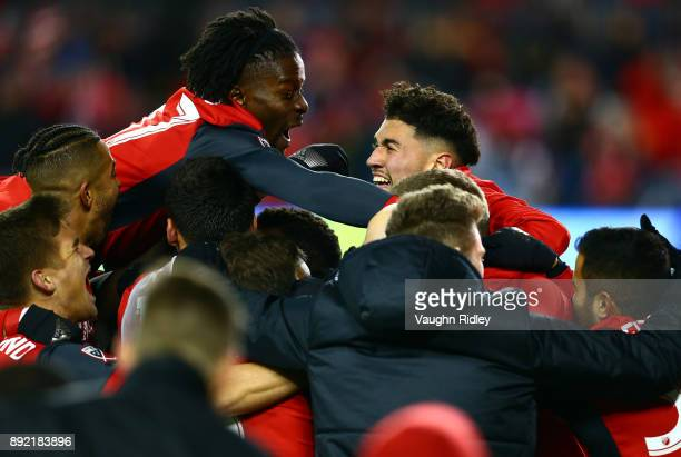 Tosaint Ricketts and Jonathan Osorio of Toronto FC celebrate their second goal by Victor Vazquez with teammates during the second half of the 2017...