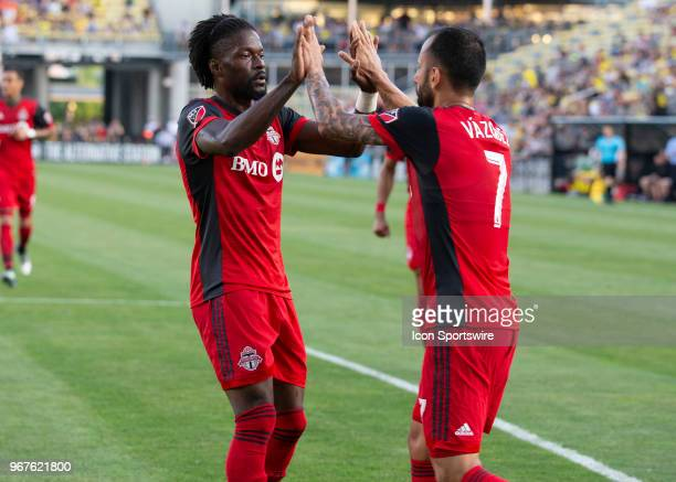 Tosaint Ricketts of Toronto FC and Victor Vazquez of Toronto FC celebrate a goal during the game between the Columbus Crew SC and the Toronto FC at...