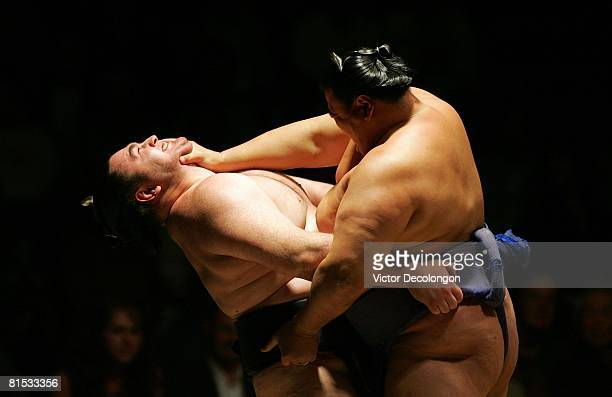 Tosanoumi pushes at the neck of Wakanoho during their second round match during the 2008 Grand Sumo Tournament at the Los Angeles Memorial Sports...