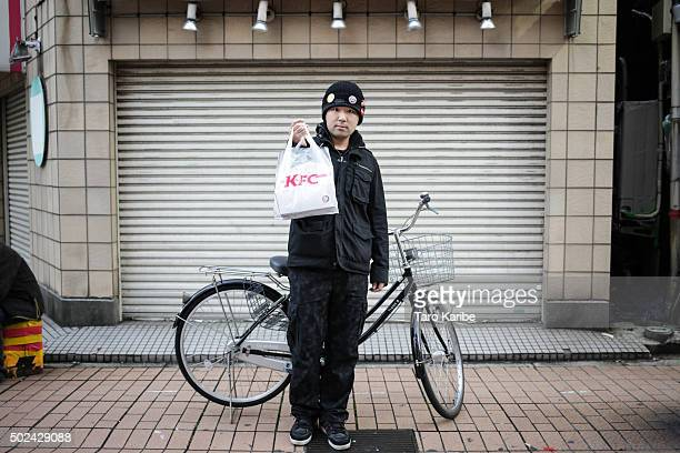 Toshiaki Minata 21 years old bought KFC for his family on December 24 2015 in Tokyo Japan Some of the popular ways to spend the Japanese Christmas...