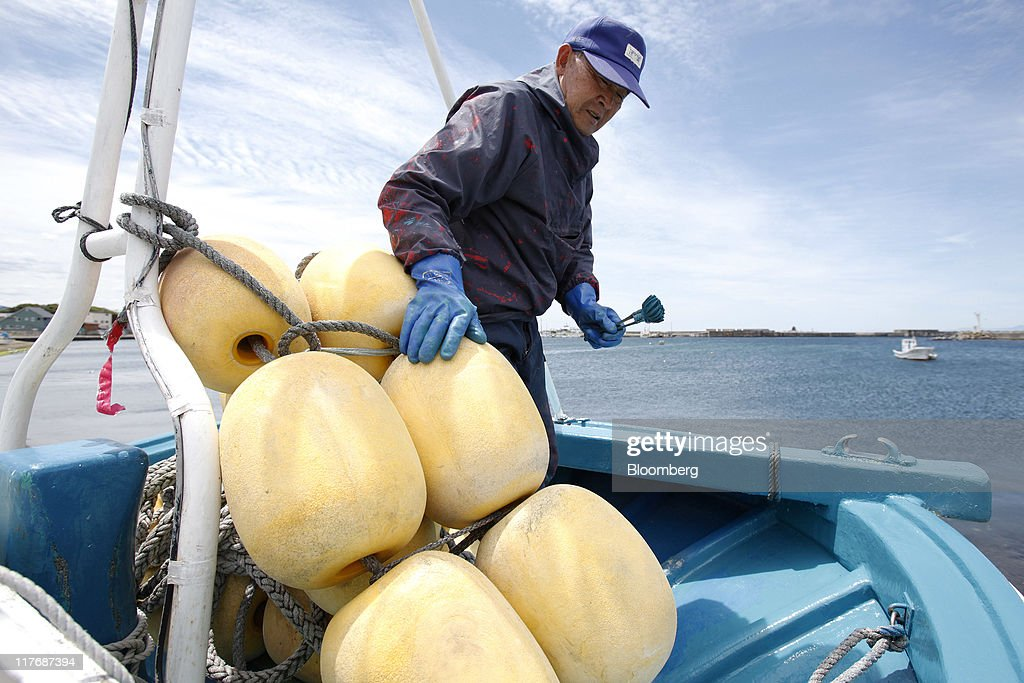 Toshiaki Sasaki, 76, paints his fishing boat at a port in Oma Town, Aomori Prefecture, Japan, on Sunday, June 26, 2011. Over the 29 years since Electric Power Development Co.'s (J-Power) nuclear plant was proposed, Oma has received almost 11 billion yen in subsidies, said Kenichi Ito, a town planning official. In Oma and other Aomori towns, the grants helped offset declining revenues that threatened the survival of rural communities, officials said. Photographer: Kiyoshi Ota/Bloomberg via Getty Images