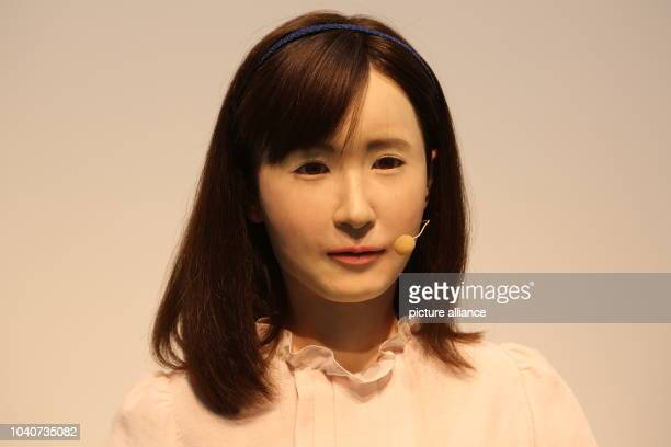 Toshiba Corp's communication android Ms Aiko Chihira uses sign language during CEATEC Japan 2014 held at at Makuhari Messe in Chiba east of Tokyo...
