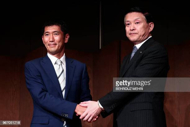 Toshiba Memory Corp President Yasuo Naruke and head of Bain Capital's operations in Japan Yuji Sugimoto shake hands after a joint press conference in...