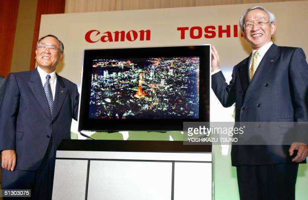 Toshiba President Tadashi Okamura and Canon President Fujio Mitarai display the prototype model of the next generation flat display panel...