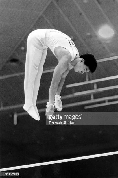 Toshiharu Sato competes in the Horizontal Bar of the Men's All Around qualification during the 42nd All Japan Artistic Gymnastic Championships at...