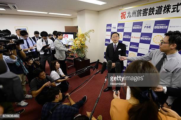 Toshihiko Aoyagi president of Kyushu Railway Co speaks to the media following the company's listing ceremony at the Fukuoka Stock Exchange in Fukuoka...