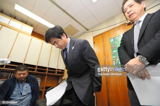 Toshihiko Furuya director of the Japan Canoe Federation bows to the media on January 9 2018 in Tokyo Japan 32yearold Yasuhiro Suzuki desperate to...