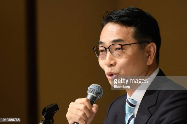 Toshihiko Katsuya chief operating officer of Monex Group Inc speaks during a news conference in Tokyo Japan on Friday April 6 2018 Coincheck the...