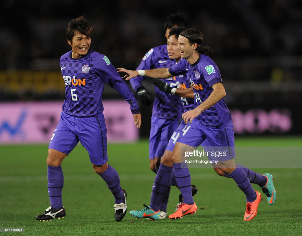 Toshihiro Aoyama celebrates his goal with his team mates, Mihael Mikic and Ryota Moriwaki of Sanfrecce Hiroshima during the FIFA Club World Cup match between Sanfrecce Hiroshima and Auckland City at International Stadium Yokohama on December 6, 2012 in Yokohama, Japan.