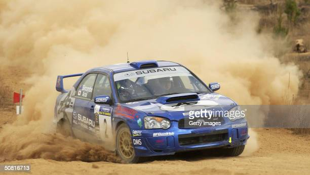 Toshihiro Arai of Japan and co-driver Tony Sircombe of New Zealand from Team Atkinson Racing drive their Subaru during stage 13 of the FIA Subaru...