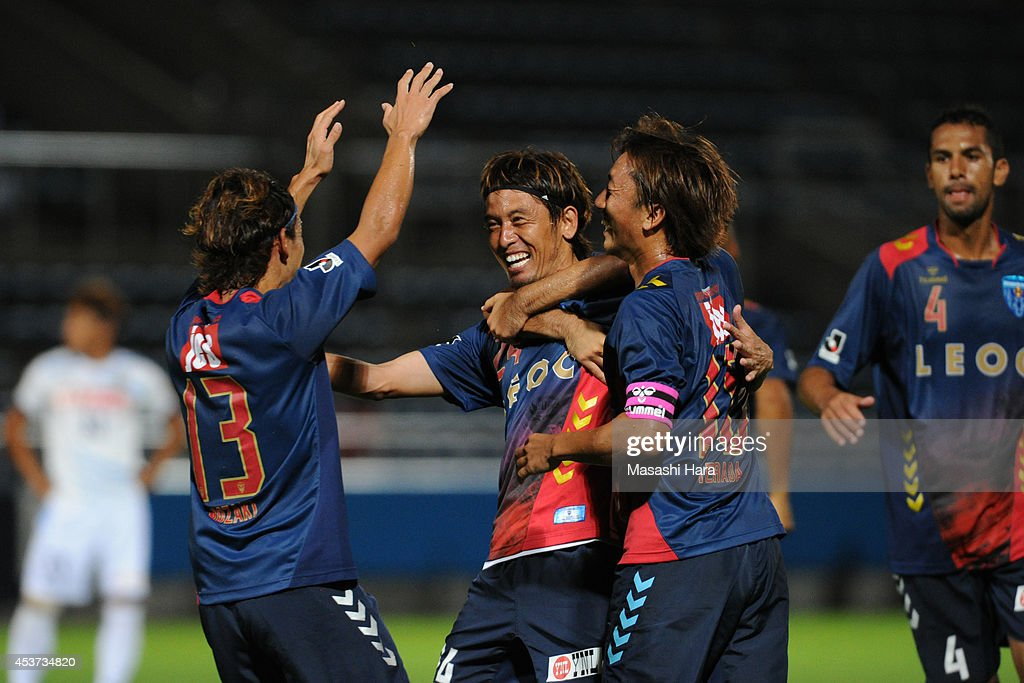 Toshihiro Matsushita #24 of Yokohama FC celebrates the third goal during the J. League 2 match between Yokohama F.C. and Kamatamare Sanuki at the Nippatsu Mitsuzawa Stadium on August 17, 2014 in Yokohama, Japan.