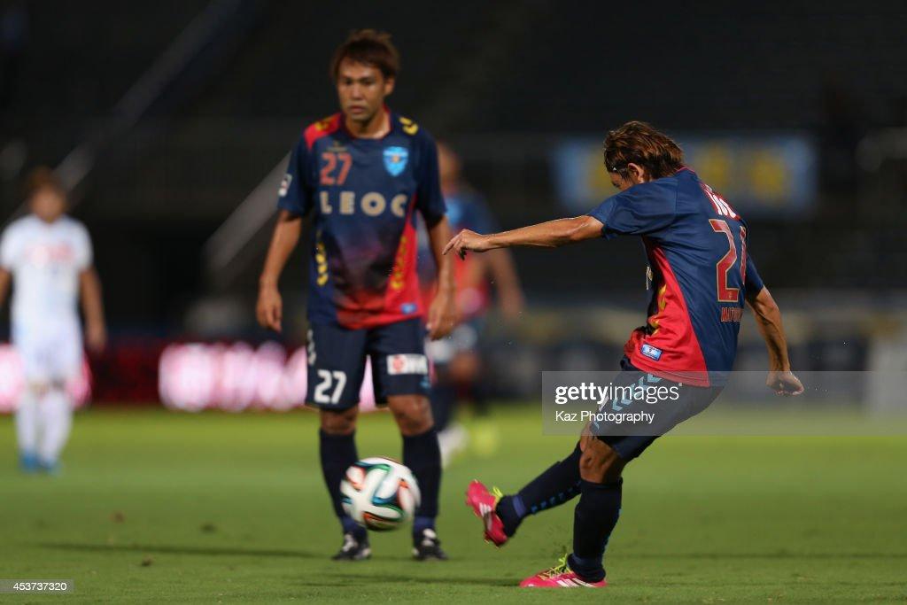 Toshihiro Matsushita of Yokohama FC scores his team's third goal during the J. League 2 match between Yokohama F.C. and Kamatamare Sanuki at the Nippatsu Mitsuzawa Stadium on August 17, 2014 in Yokohama, Japan.