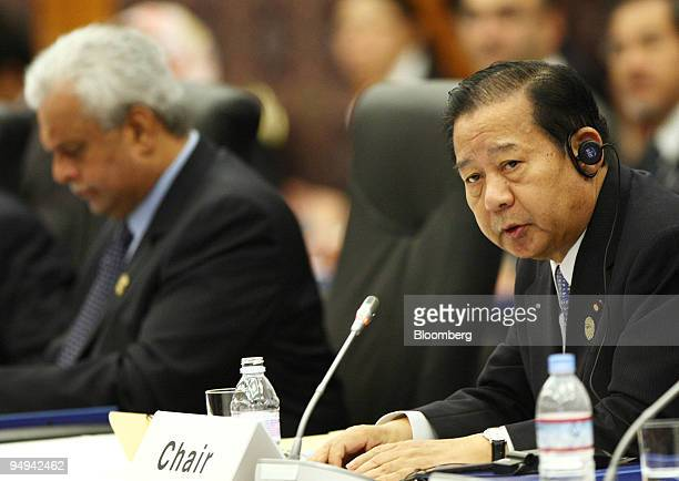 Toshihiro Nikai Japan's economy trade and industry minister right speaks as Abdullah bin Hamad alAttiyah Qatar's deputy prime minister and minister...