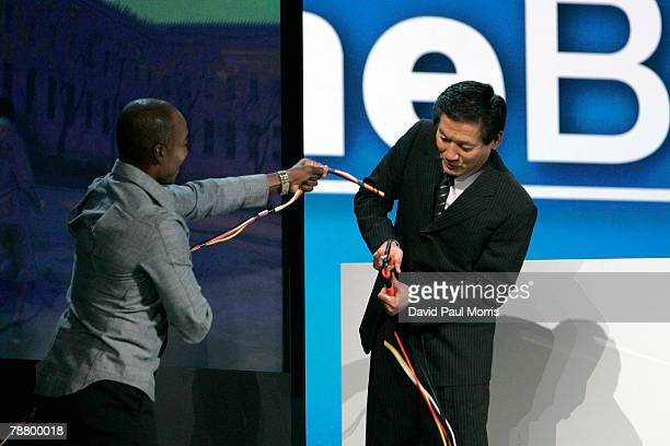 Toshihiro Sakamoto President of Panasonic AVC Networks Company cuts wires connecting a TV as he introduces homebase a wireless entertainment systems...