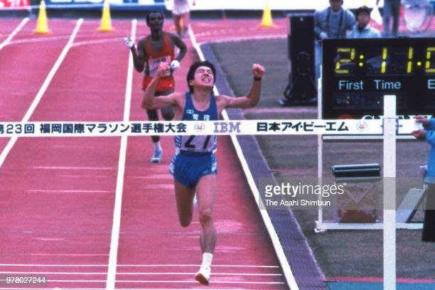 Toshihiro Shibutani of Japan crosses the finish tape to win the 23rd Fukuoka International Marathon at the Heiwadai Athletic Stadium on December 4...