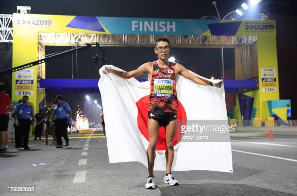 Toshikazu Yamanishi of Japan poses after winning the 20 Kilometres Race Walk Final during day eight of 17th IAAF World Athletics Championships Doha...