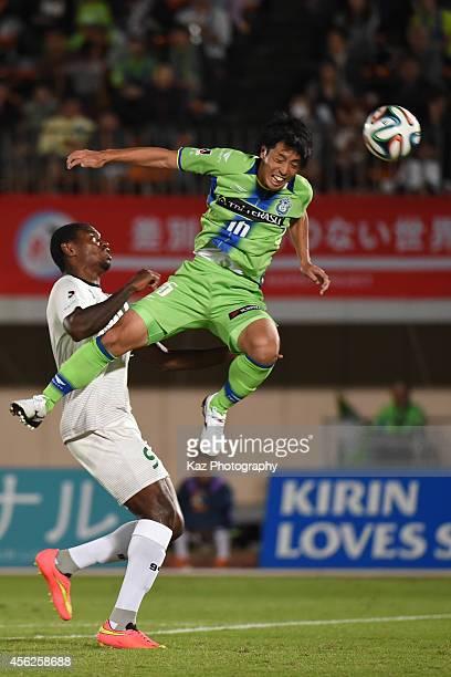 Toshiki Ishikawa of Shonan Bellmare wins the header over Nazarit of FC Gifu during the J League second division match between FC Gifu and Shonan...