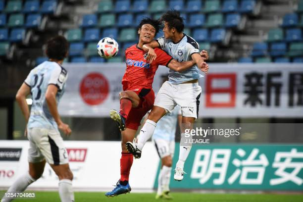 Toshiki Takahashi of Roasso Kumamoto and Kotaro Fujiwara of Kagoshima United compete for the ball during the JLeague Meiji Yasuda J3 match between...