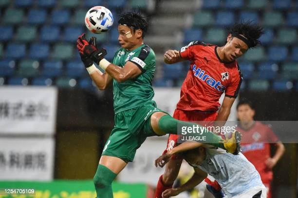 Toshiki Takahashi of Roasso Kumamoto and Shogo Onishi of Kagoshima United compete for the ball during the JLeague Meiji Yasuda J3 match between...