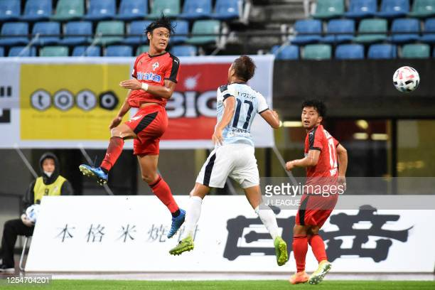 Toshiki Takahashi of Roasso Kumamoto and Yusei Kayanuma of Kagoshima United compete for the ball during the JLeague Meiji Yasuda J3 match between...