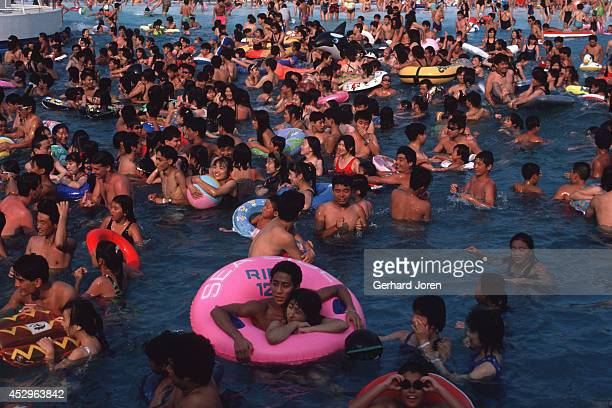 Toshimaen swimming pool in Tokyo sees crowds every weekend It has seven swimming pools one with artificial waves a 40x50m 'Niagara Pool' and three...
