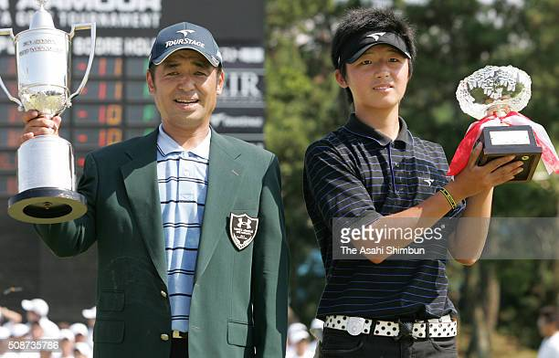 Toshimitsu Izawa of Japan and low amateur Ryota Ito pose with trophies after winning the Under Armour KBC Augusta at the Keya Golf Club on August 28...