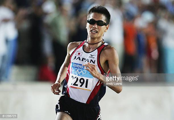 Toshinari Suwa of Japan enters the stadium before finishing the men's marathon on August 29 2004 during the Athens 2004 Summer Olympic Games at...