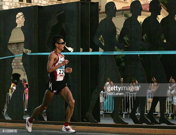 Toshinari Suwa of Japan runs in the men's marathon on August 29 2004 during the Athens 2004 Summer Olympic Games at Panathinaiko Stadium in Athens...