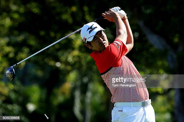 Toshinori Muto of Japan plays his shot from the first tee during the first round of the Sony Open In Hawaii at Waialae Country Club on January 14...