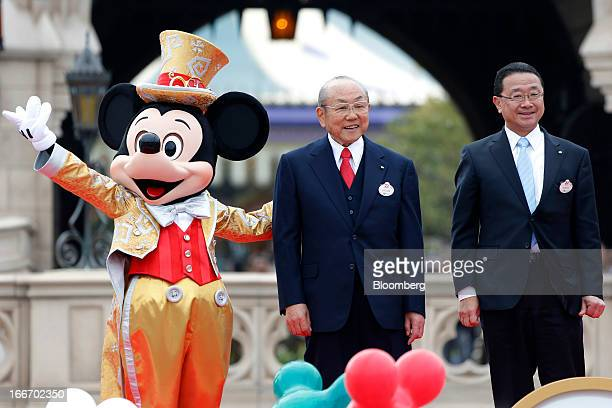 Toshio Kagami chairman and chief executive officer of Oriental Land Co center and Kyoichiro Uenishi president and chief operating officer right stand...