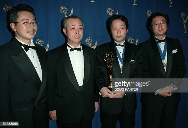 Toshio Shirai, Masahiro Yamamoto, Toshiyuki Izumi, and Ryuzo Sawada of Japan pose with their award at the 27th Annual International Emmys in New York...
