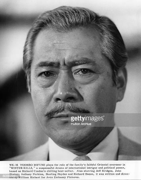 Toshiro Mifune looks on in a scene from the movie 'Winter Kills' circa 1979